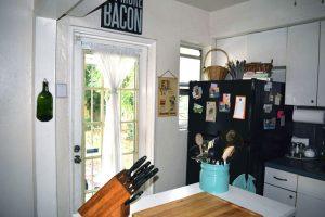 Kitchen with door to backyard