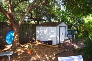 Shed in fenced backyard
