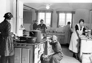 Women Cleaning Kitchen